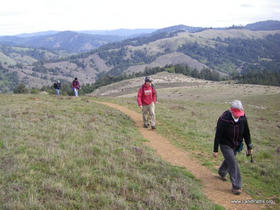 Hikers traverse a rarely accessible ridgetop on a previous Landpaths outing in the far west of Sonoma County.
